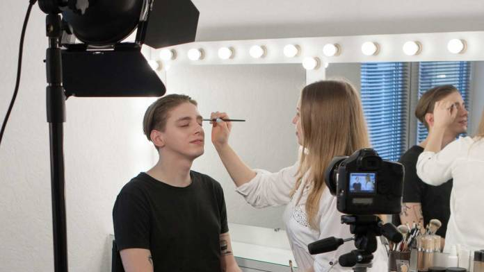 Person getting makeup appied