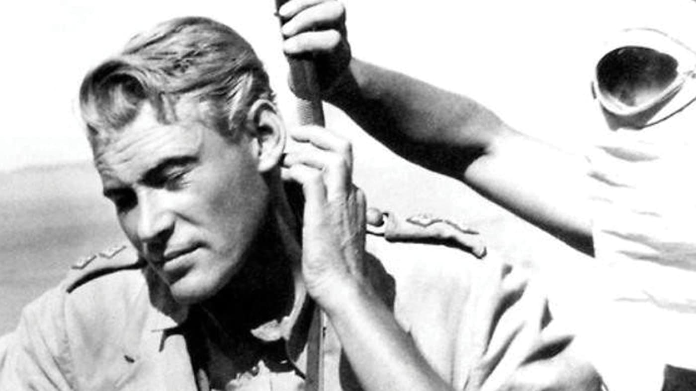 Behind the scenes shot of Lawrence of Arabia showing stylist touching up Peter O'Toole.