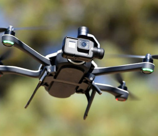A drone flying with a camera attached to its front