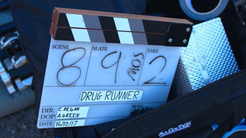 """""""Drug Runner"""" production clapboard"""