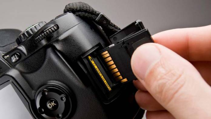 Memory card being inserted into a camera