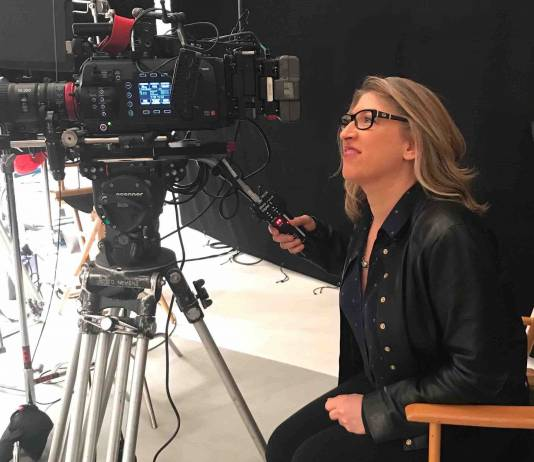 Lauren Greenfield on set shooting with Canon camera. Photo Frank Evers