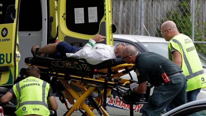 Ambulance taking a man from outside a mosque in central Christchurch, New Zealand