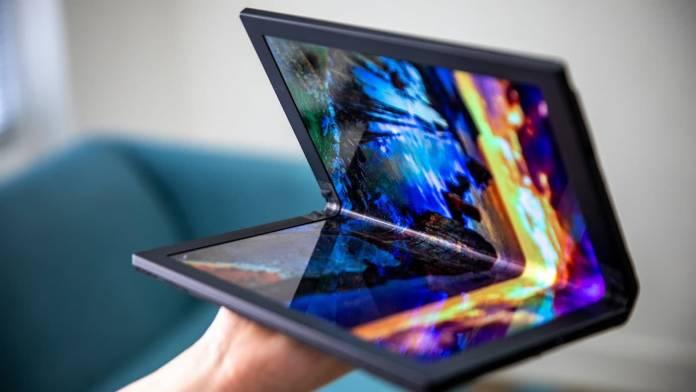 Hands holding Lenovo's foldable ThinkPad X1 PC