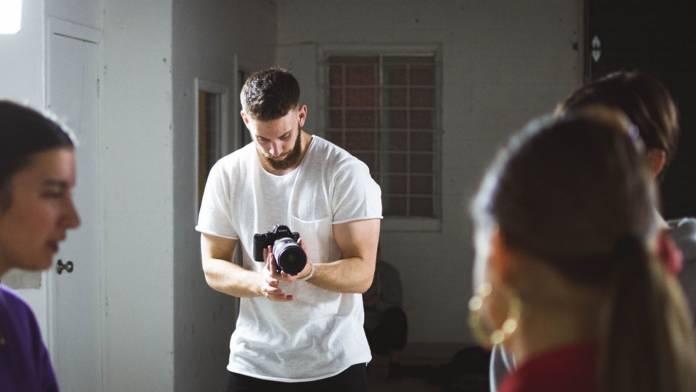 Director filming actors on set