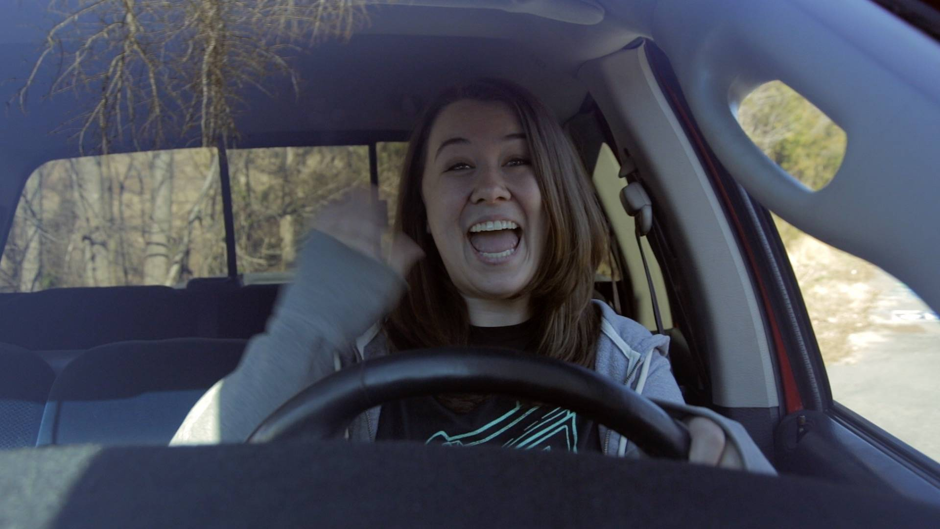 Hood-mounted shot of actor through windshield.