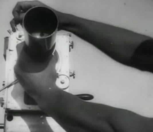"Scene from ""Man with a Movie Camera"" (1929) Hands adjusting a camera"