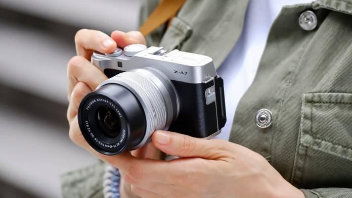 Fujifilm X-A7 being held