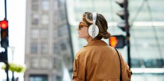Momentum Wireless headphones being worn in the streets of a city