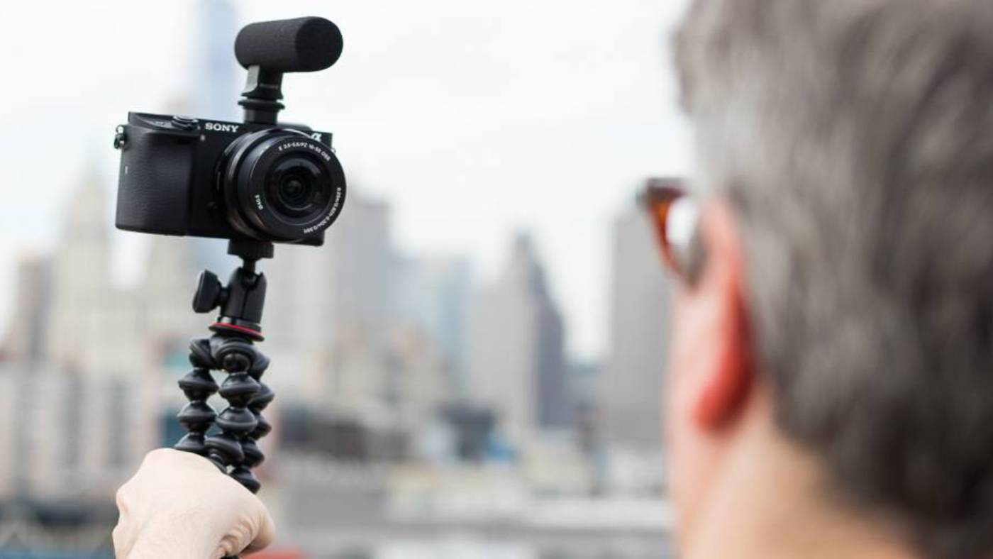 Man vlogging with camera on tripod