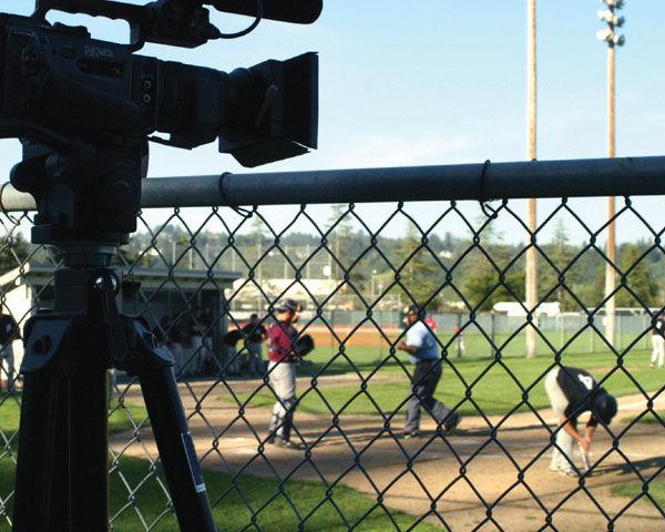 camcorder-on-tripod-shooting-baseball-field