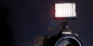 A small LED light on top of a DSLR camera