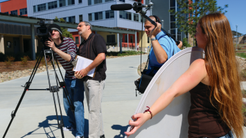 Three college students and instructor on a video shoot