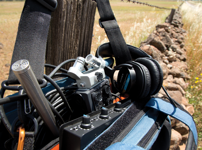 Audio gear along a rock fence
