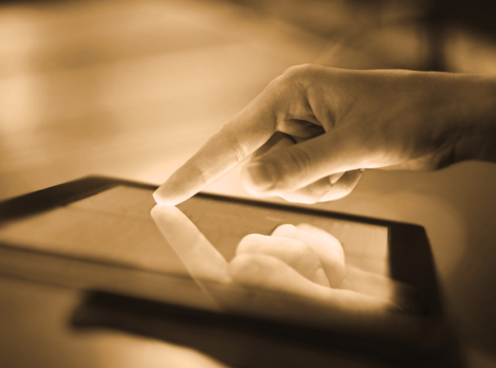 Photo of a hand on a tablet