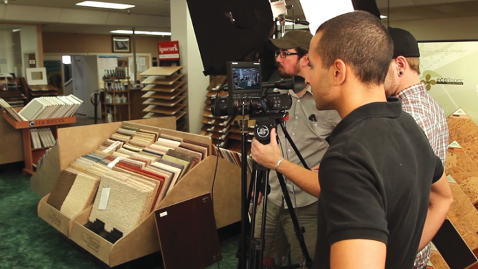 Video crew at carpet store shooting an ad.