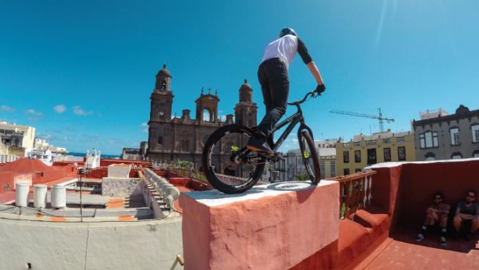 BMX rider on rooftop