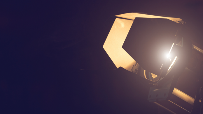 Light with barndoors in a dark studio
