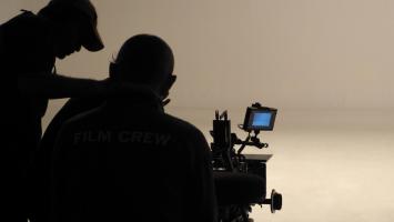 Two man film crew shooting.