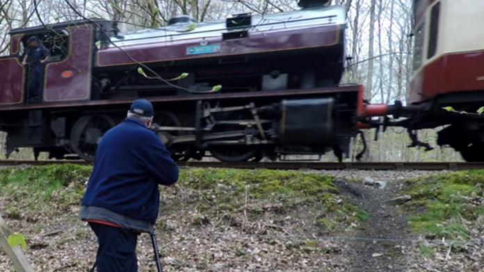 Rob Ellerby near a train with his gear