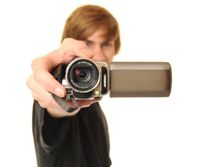 Young-Adult-Holding-Camcorder