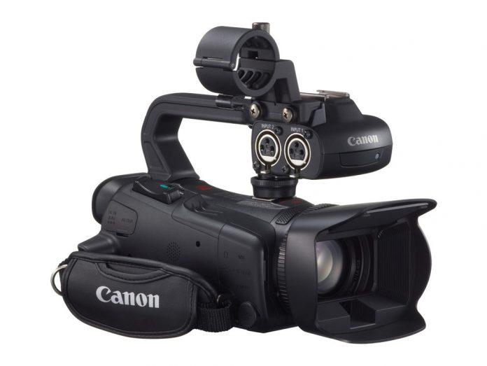 Canon camcorder with lens hood and XLR inputs on the handle