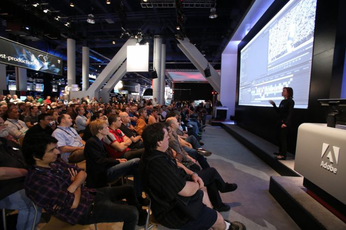 Many NAB attendees view an Adobe presentation