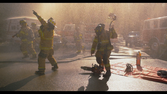 Firefighters prepare gear and get into position