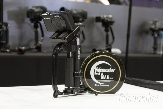 Videomaker award next to a small camera on a metal contraption