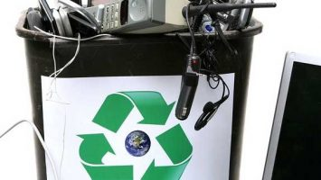 Trash can full of obsolete electronics