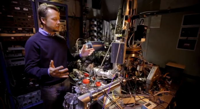 IBM's Andreas Heinrich standing in the microscope room used to shoot A Boy and His Atom.