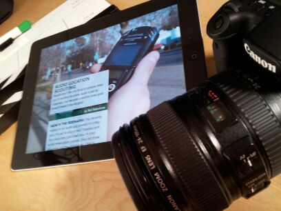 Photo of an iPad and DSLR camera