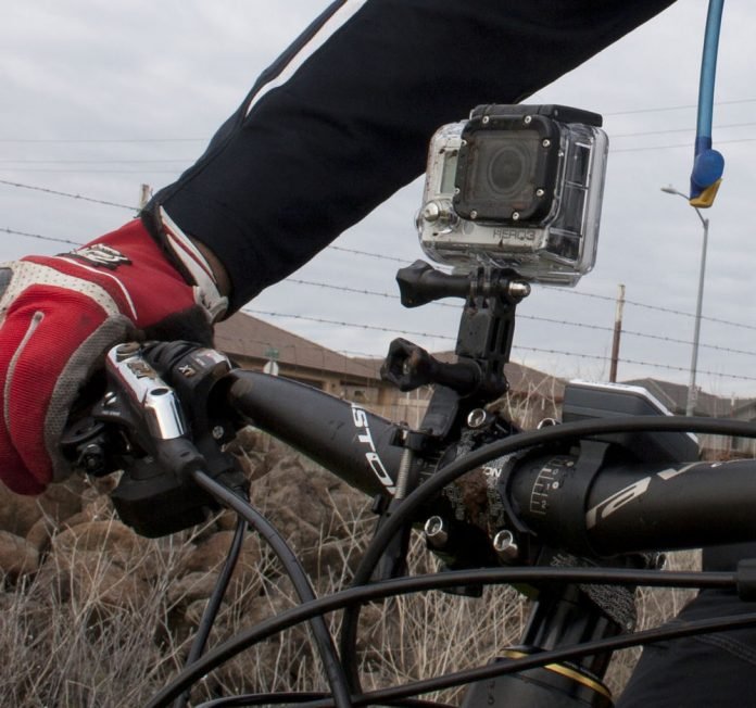 GoPro action camera mounted on a bicycle's handlebars