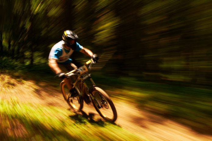 shot of a cyclist riding extremely fast