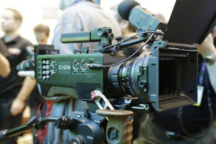 Cinema camera setup in a crowd