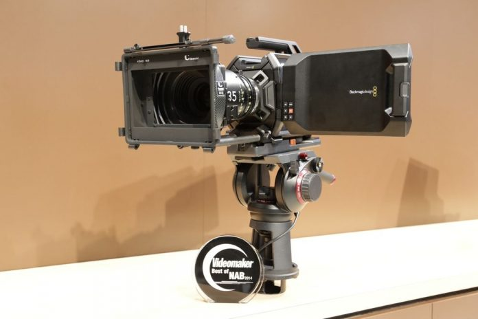 Large camera on a tripod head with an award