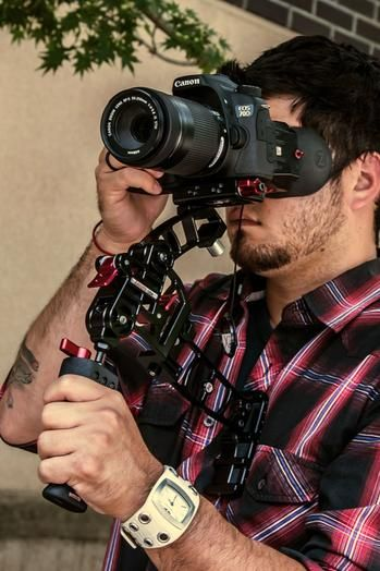 Man with a DSLR and camera support