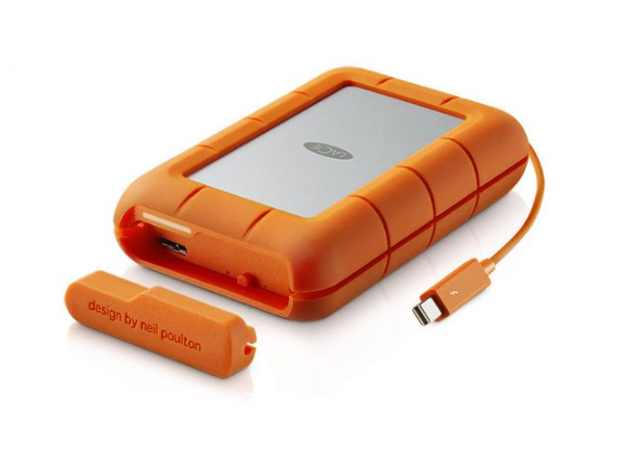 Orange and silver portable drive with cable attached and panel removed