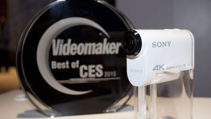Uncased white action cam on display with an award