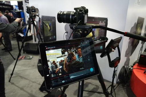 camera and iPad at a tradeshow