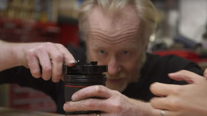 Adam Savage Attempting to Use Filter Wrench.   Photo Courtesy of Tested via Youtube.com