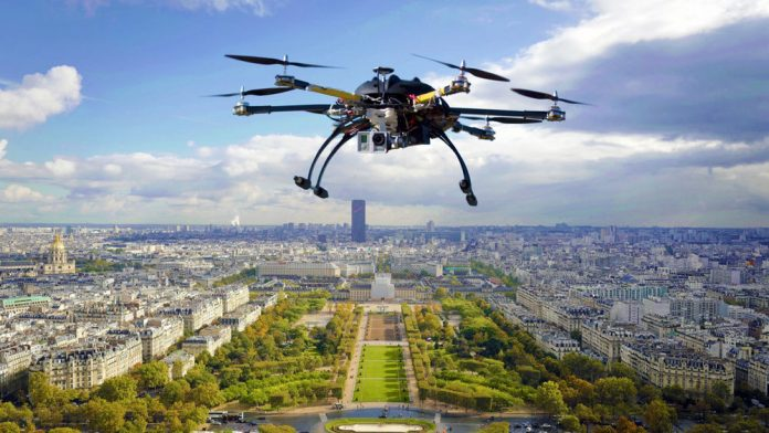 Image of a drone hovering above a city